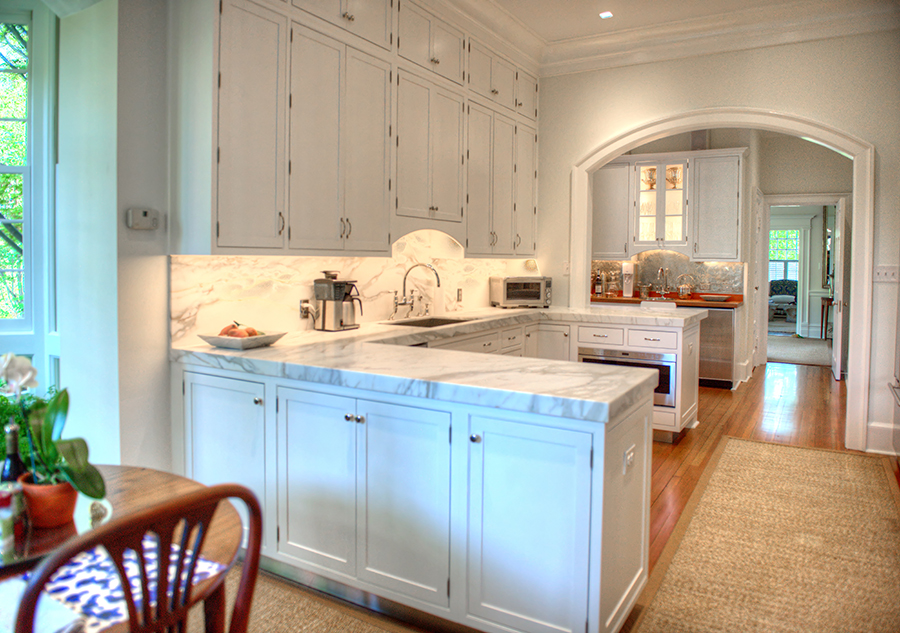White Painted Cabinets Central To Beautiful Kitchen Renovation